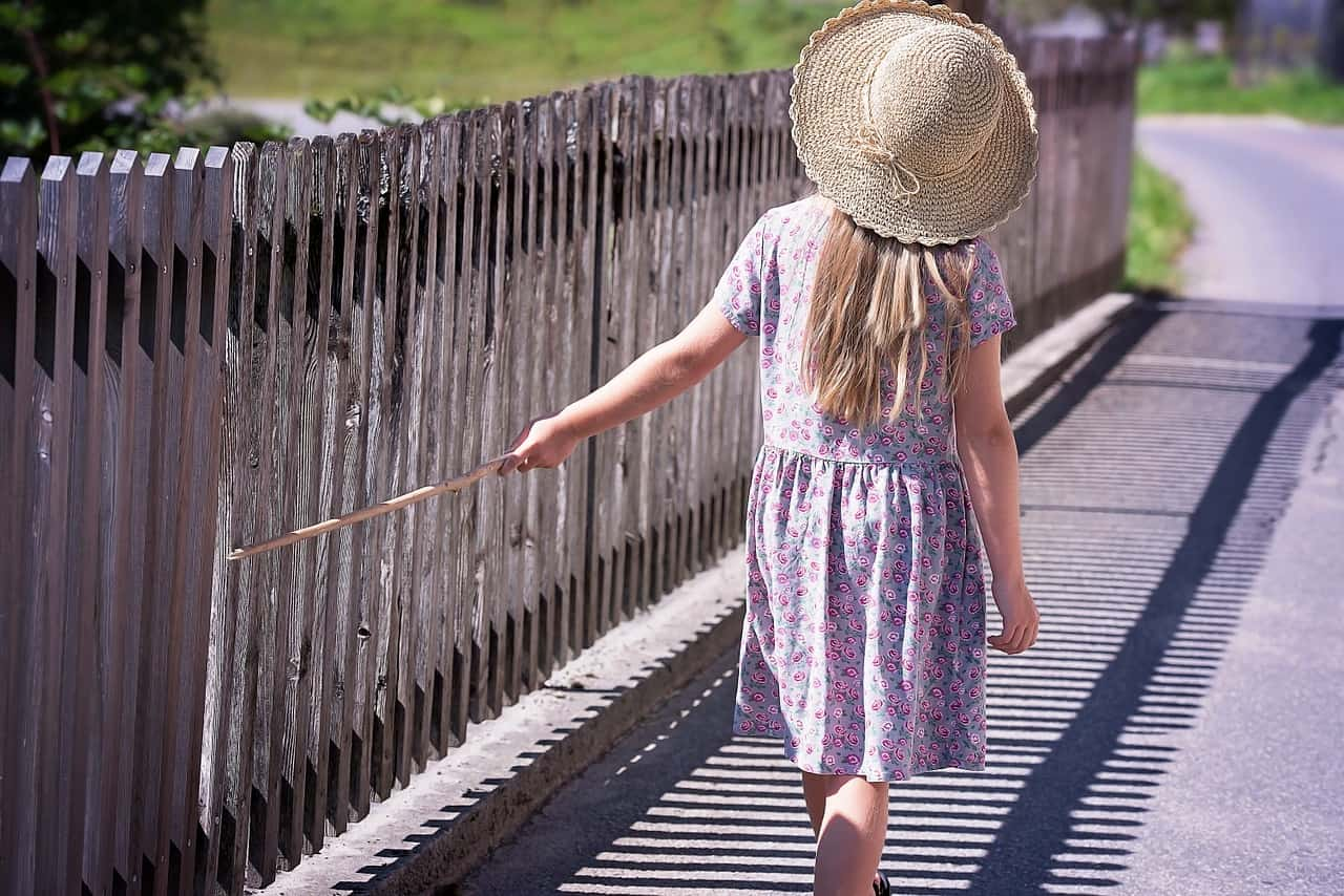 wooden picket fence and a girl
